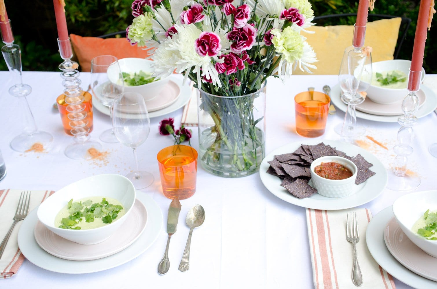 Brighten up your Cinco de Mayo tabletop with pops of orange, yellow and blush, and bring in colored water glasses and striped napkins for some pizazz.