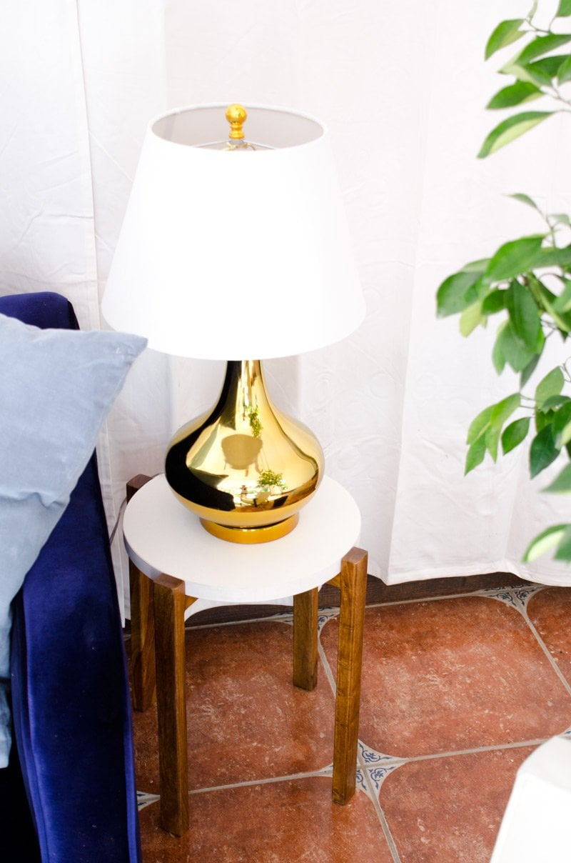 Modern side table and gold table lamp.