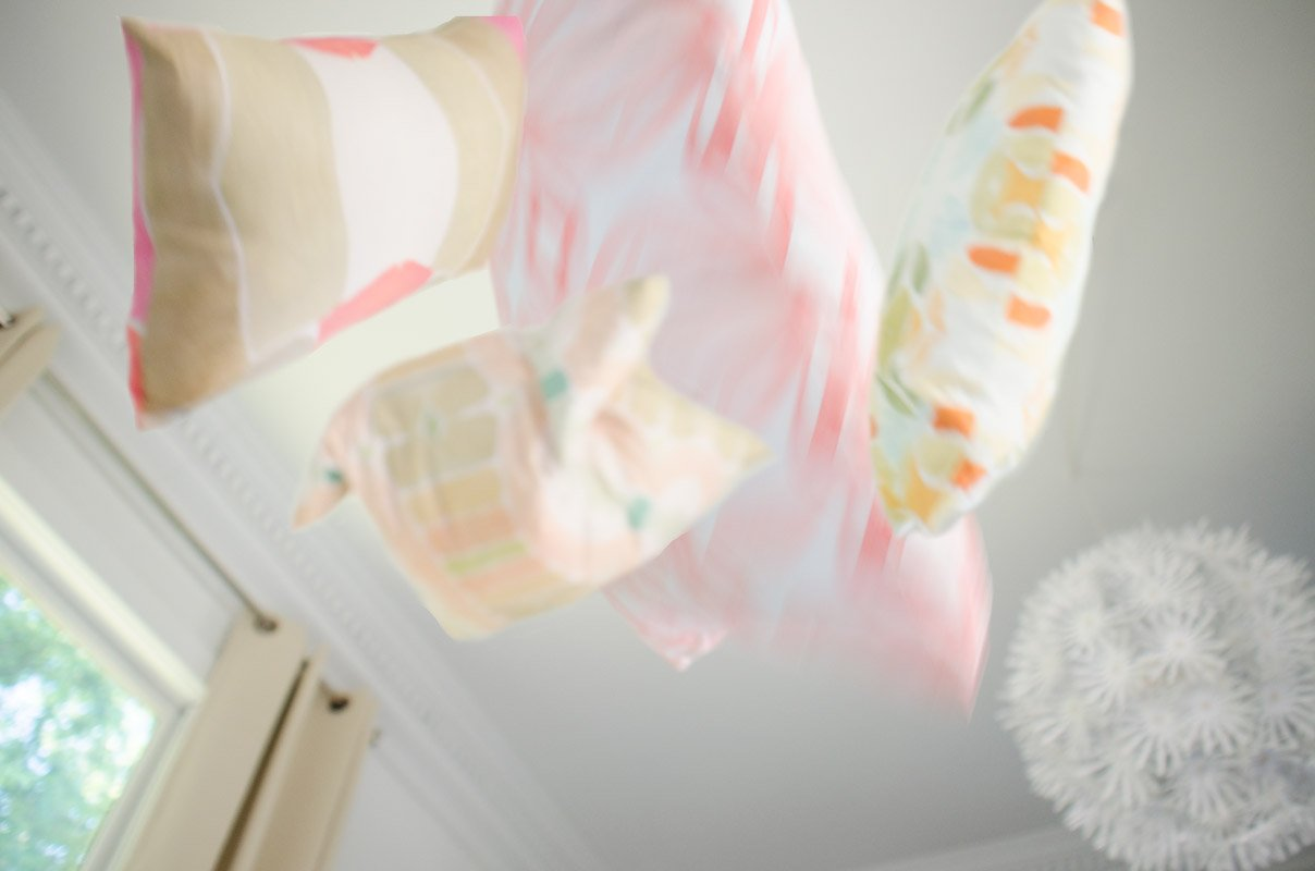 Bunglo Home spring pillows with pops of watercolor patterns