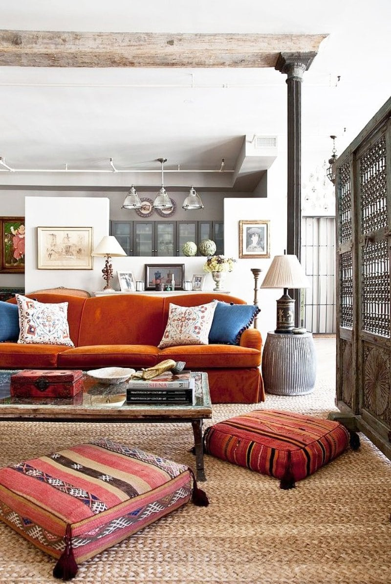A lively worldly eclectic mix in a layered living room.