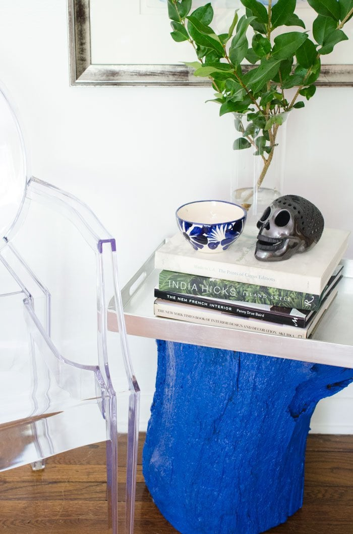 A bold blue DIY painted stump side table.