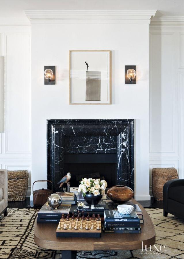 Black marble fireplace mantel surround on Thou Swell @thouswellblog