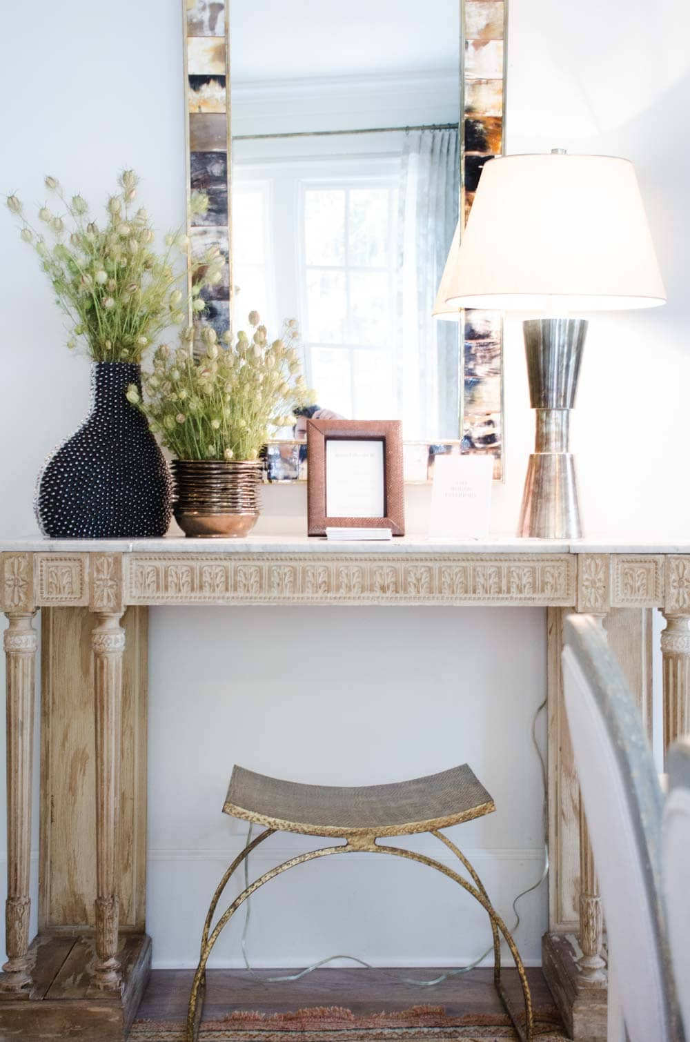 Serene neutral vignette with bleached wood console table and mirror