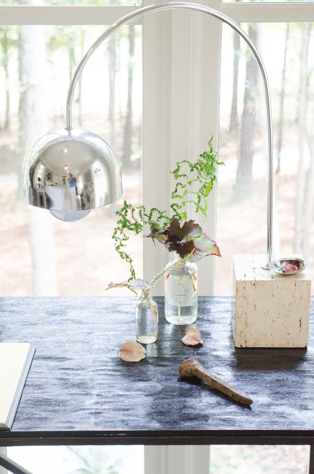 Tabletop vignette from master bedroom with modern chrome desk lamp