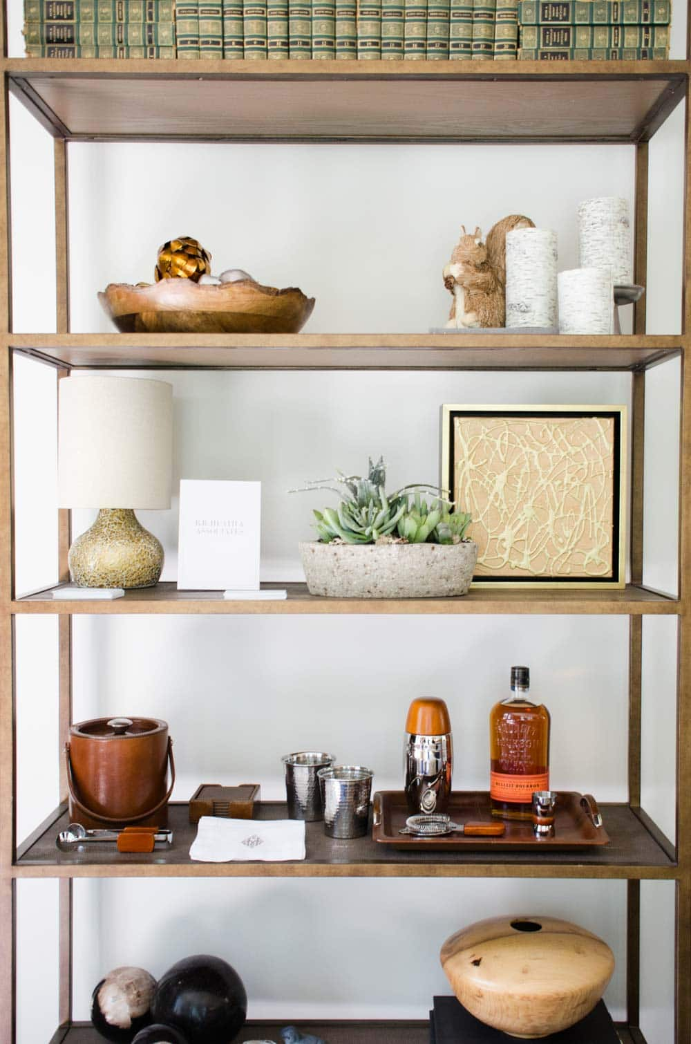 Shelf styling with mini-bar and books