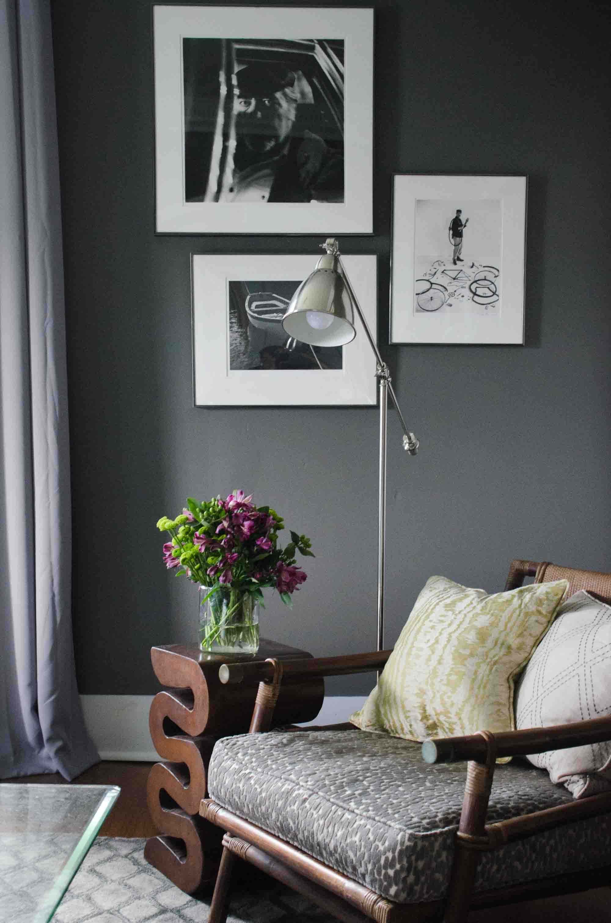 Charcoal grey walls and silver accents in a moody modern living room