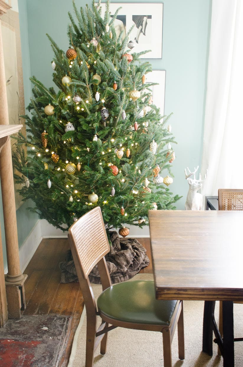 a metallic woodland christmas tree and holiday decor on thouswellblog