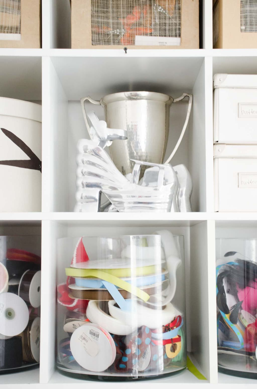 Organized shelves in a home office on @thouswellblog
