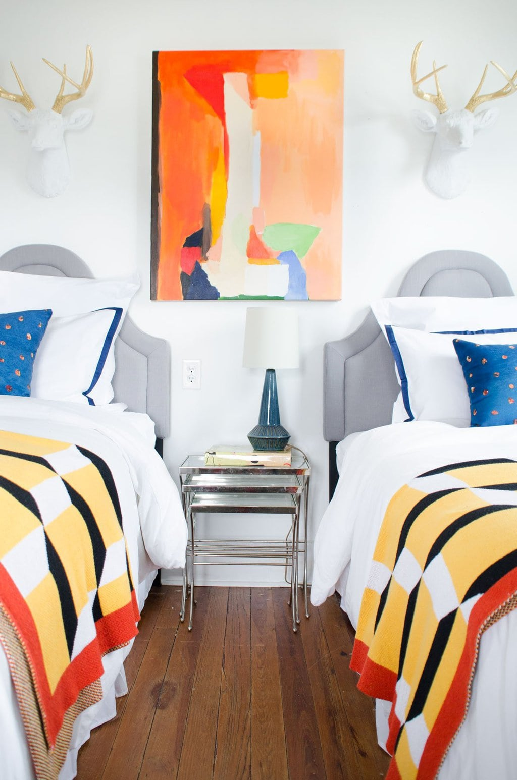 Colorful bedroom makeover with faux taxidermy and graphic accessories via @thouswellblog