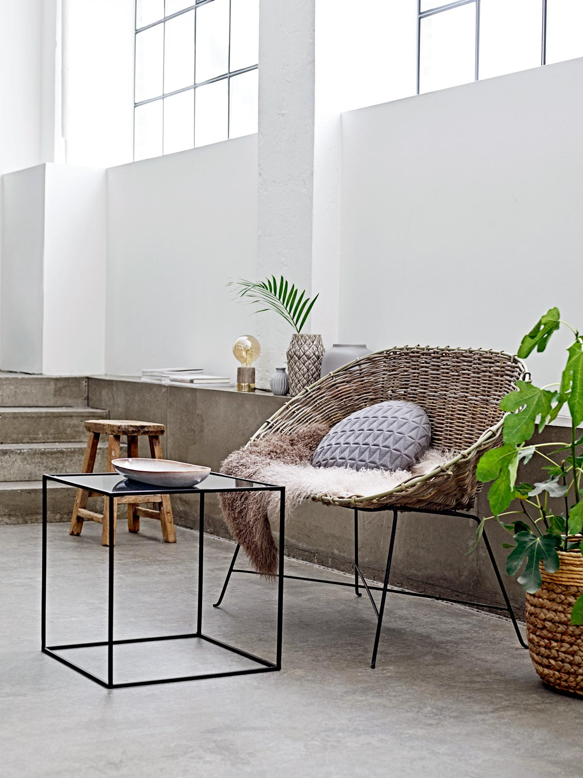 Modern loft with wicker chaise and modern decor on @thouswellblog