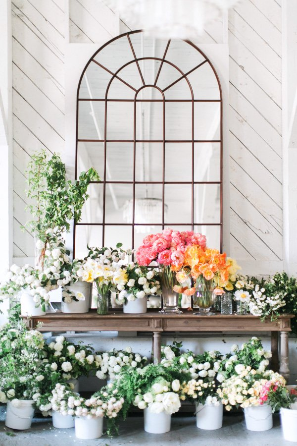 Mirrored window with flowers on @thouswellblog