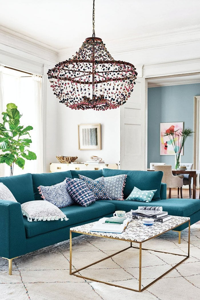 Living room with beaded chandelier and tassel home decor via @thouswellblog