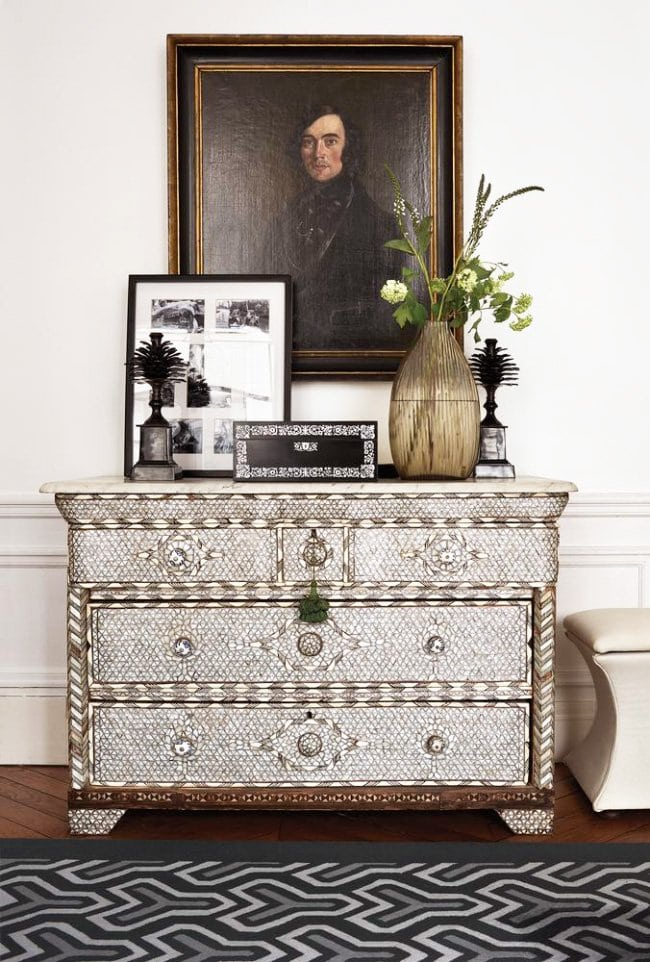 Vintage dresser and oil painting in Parisian apartment via @thouswellblog