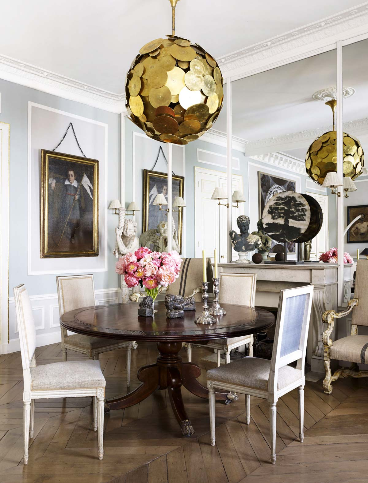 Chic french dining room with modern chandelier