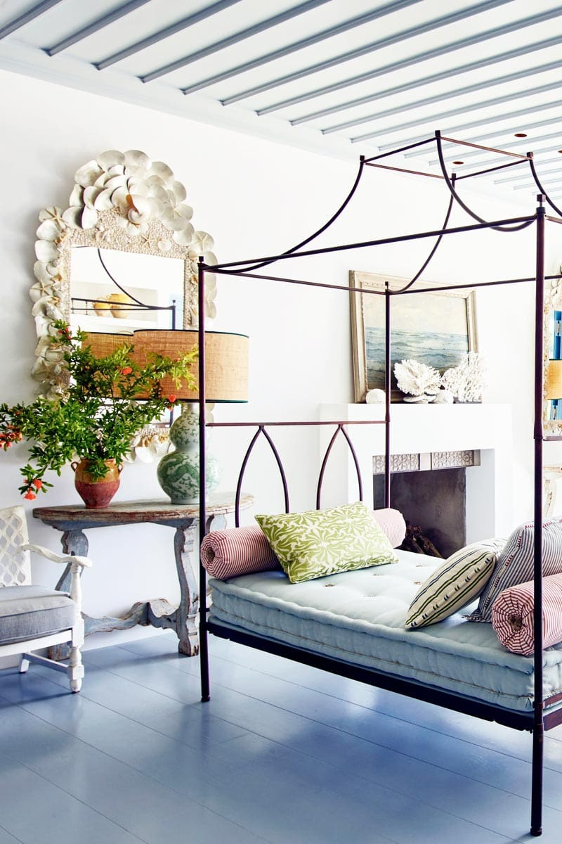 Metal canopy daybed in a Mediterranean living room via @thouswellblog