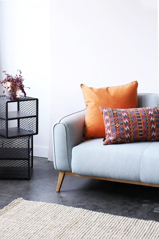 Pale blue sofa and mesh cube side tables from Furniture Maison via @thouswellblog