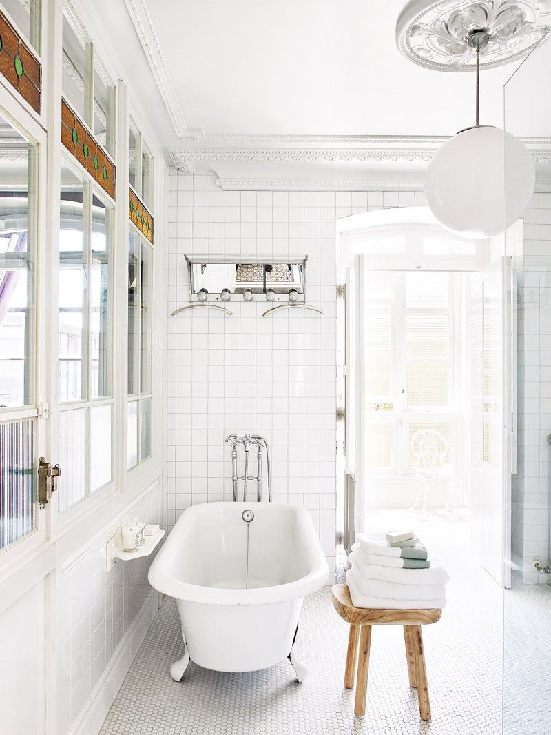 Clean white tile bathroom in eclectic home via @thouswellblog