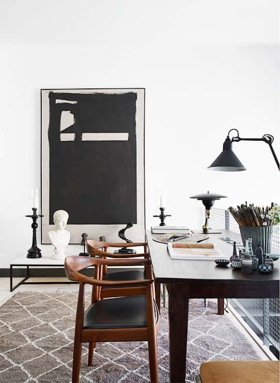 Black and white home office with large artwork via Thou Swell