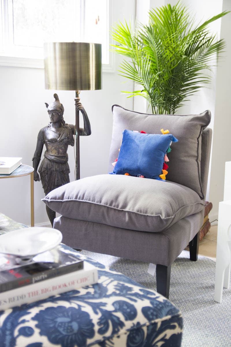 Grey accent chair and palm with floor lamp and brass lampshade on Thou Swell