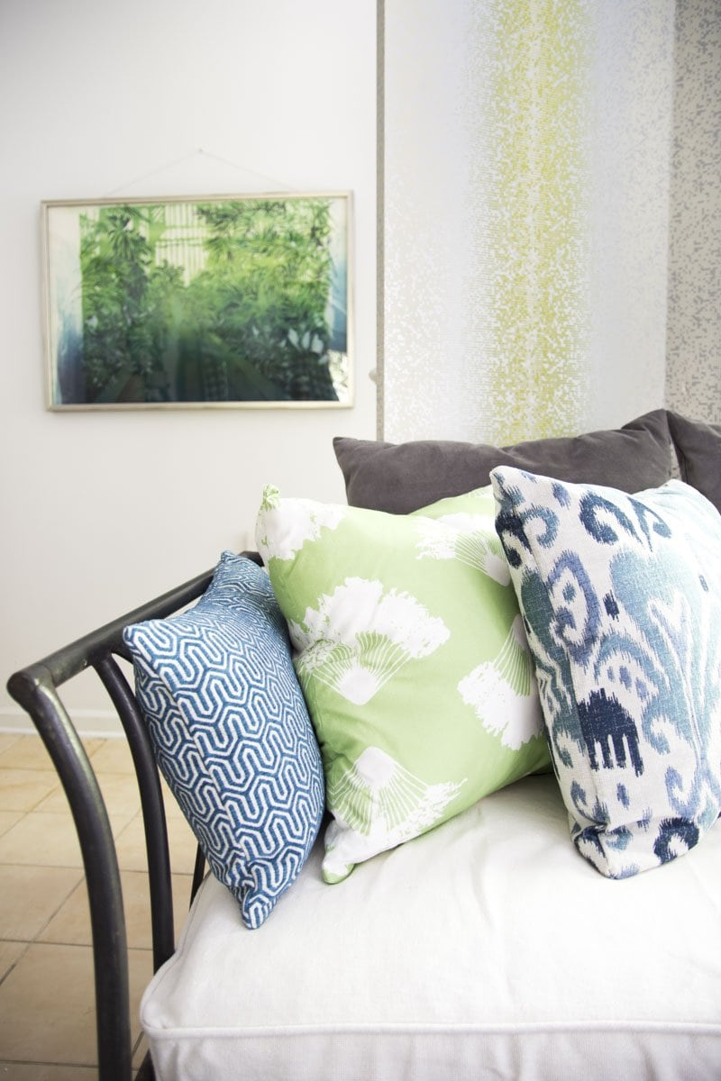 Blue and green throw pillows on bohemian daybed on Thou Swell