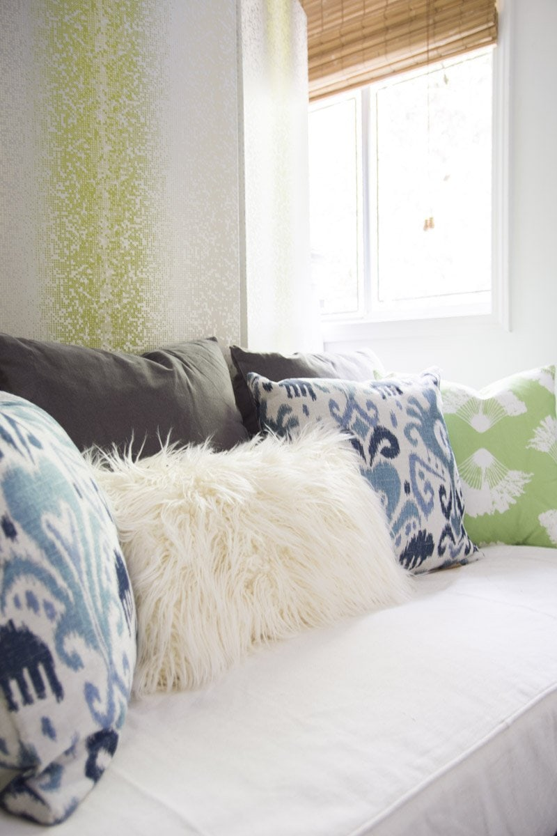 Bohemian daybed with blue and green throw pillows on Thou Swell