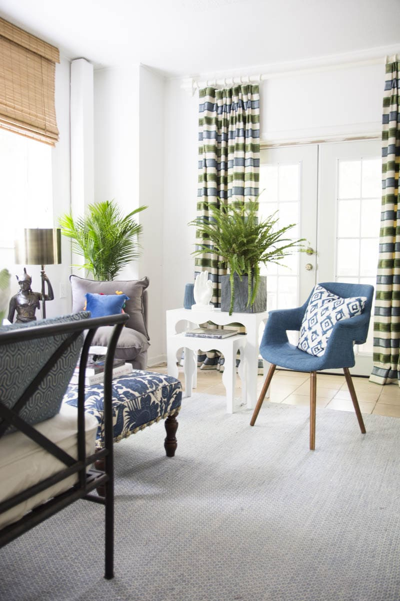 Blue green guest room with fern, palm, and Moroccan side tables on Thou Swell