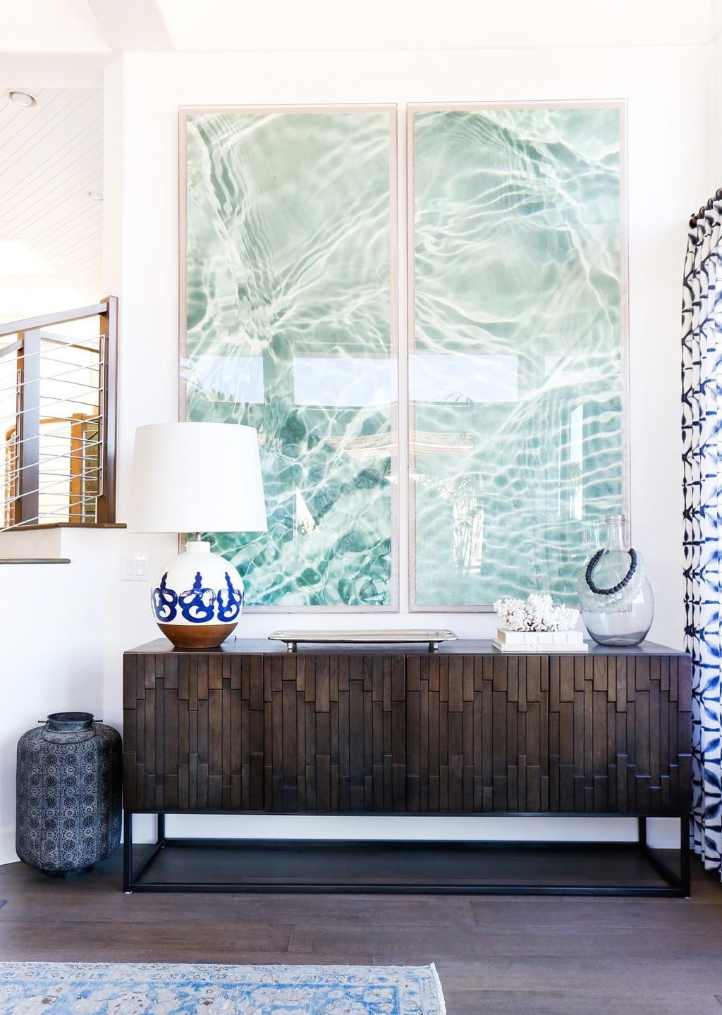 Blue water diptych artwork in coastal beach living room on Thou Swell @thouswellblog