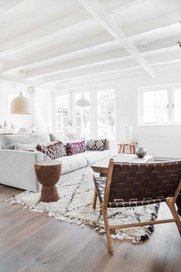 Woven leather lounge chair in white Scandinavian living room on Thou Swell @thouswellblog