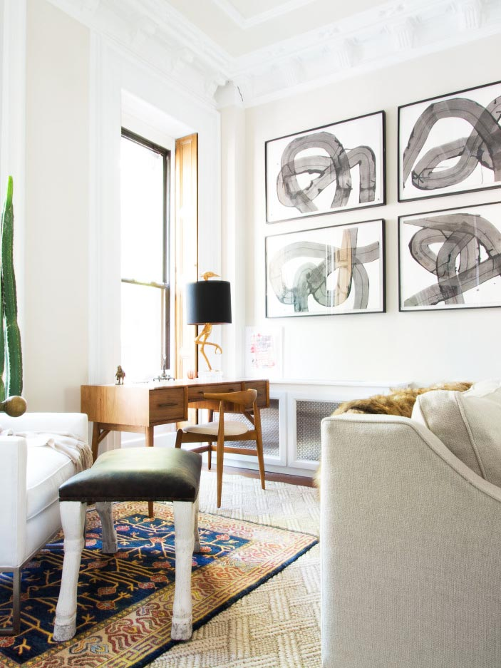 Neutral living room design with desk in the window on Thou Swell @thouswellblog