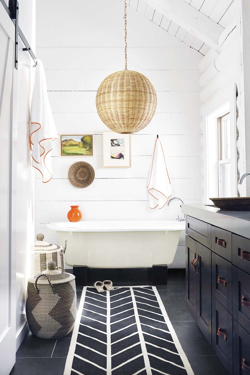 Playful bathroom design with wicker pendant and decorative baskets on Thou Swell @thouswellblog