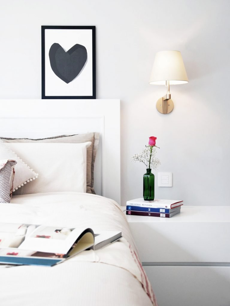 Gold shaded sconce beside bed in Scandinavian bedroom - how to choose bedroom lighting on Thou Swell @thouswellblog