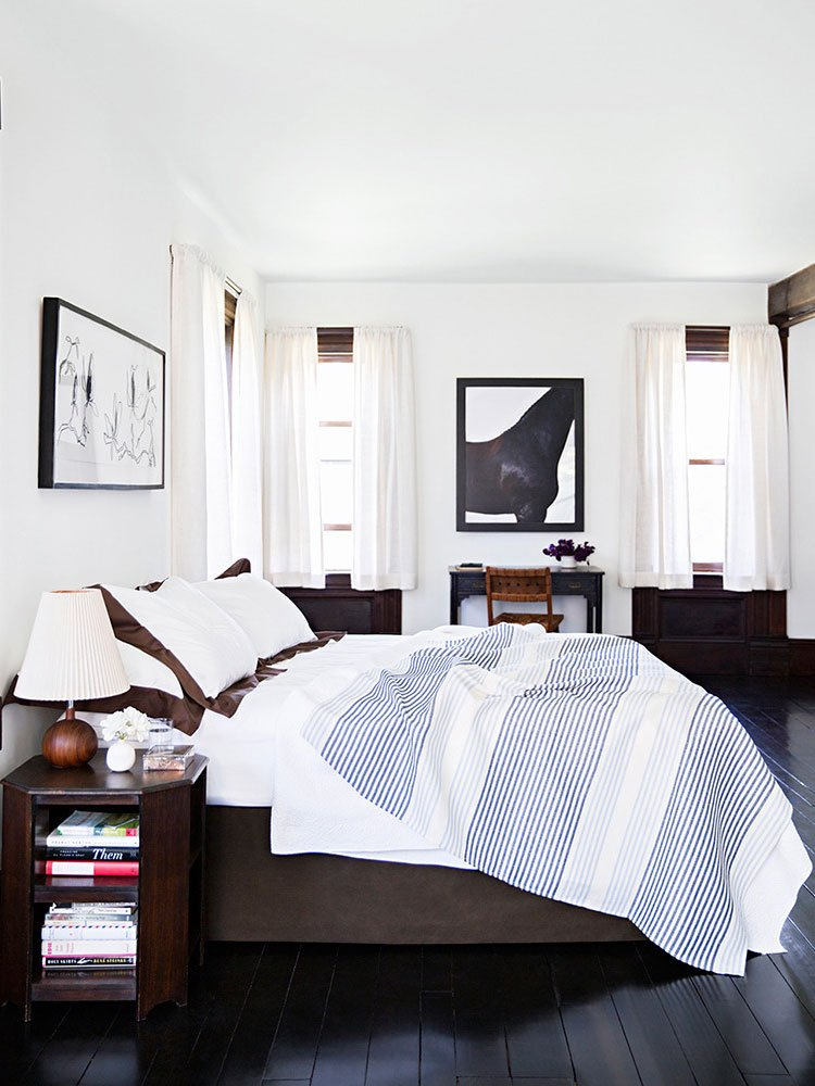 Dark brown and white bedroom with striped coverlet, black and white photography, and black floors - how to choose bedroom lighting on Thou Swell @thouswellblog