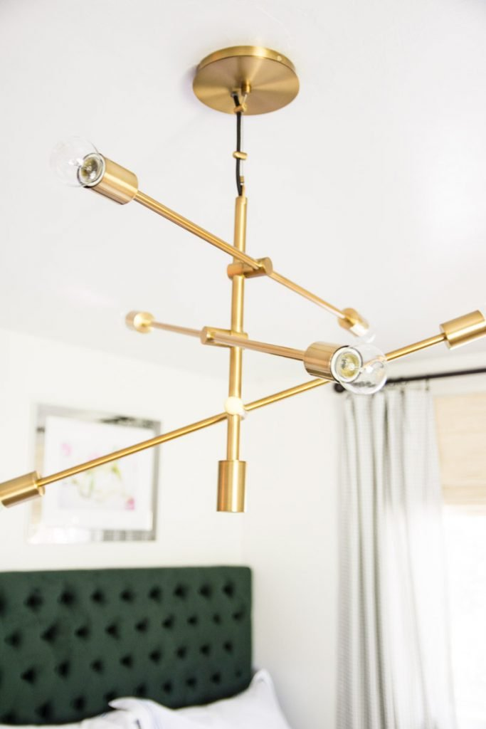 Pretty gold mobile chandelier from west elm on Thou Swell @thouswellblog