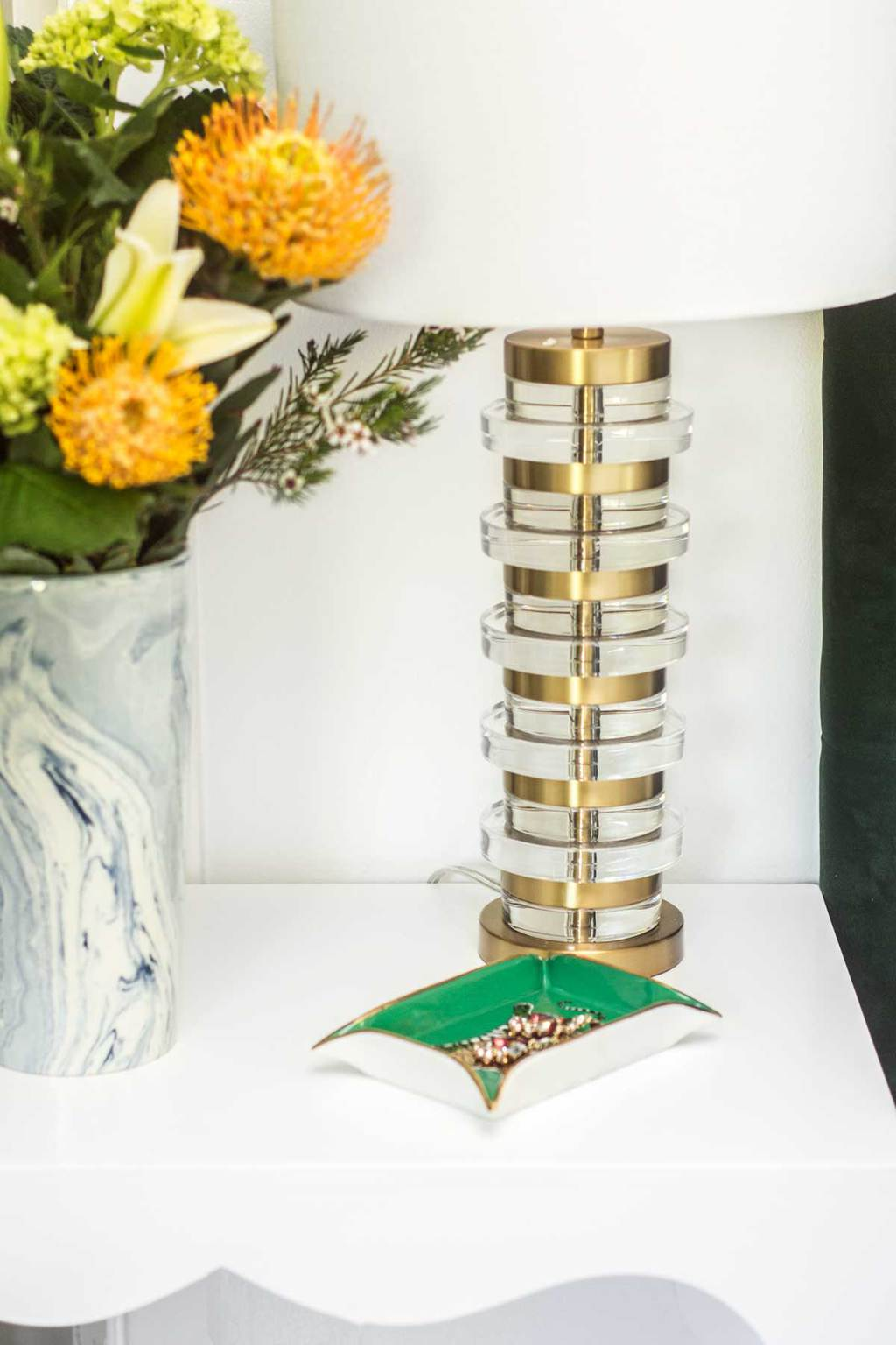 Brass table lamp and blue marbleized vase on bedside table via Thou Swell @thouswellblog