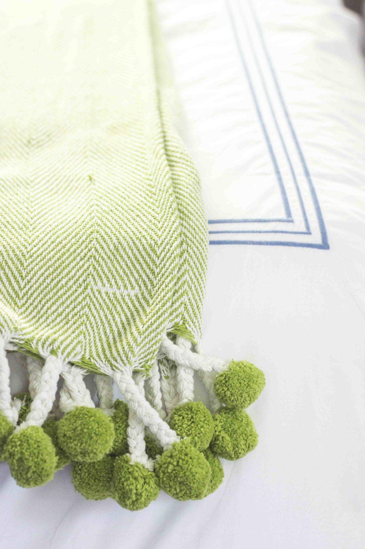 Lime green herringbone pom pom throw blanket from Waiting on Martha via Thou Swell @thouswellblog