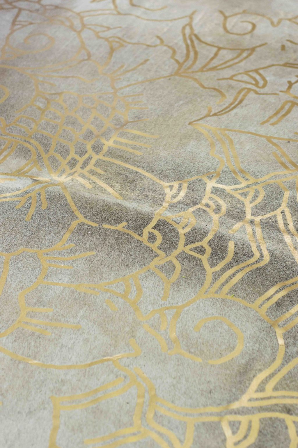 Hide rug with gold pattern on Thou Swell @thouswellblog