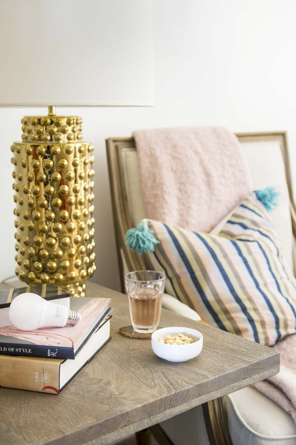 Living room vignette with Robert Allen gold hobnail lamp and Hive Active Light on Thou Swell @thouswellblog