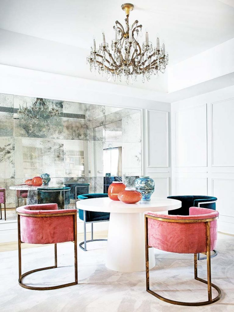 ae0d46ab819 Glamorous dining room with pink velvet dining chairs and mirrored wall on  Thou Swell  thouswellblog
