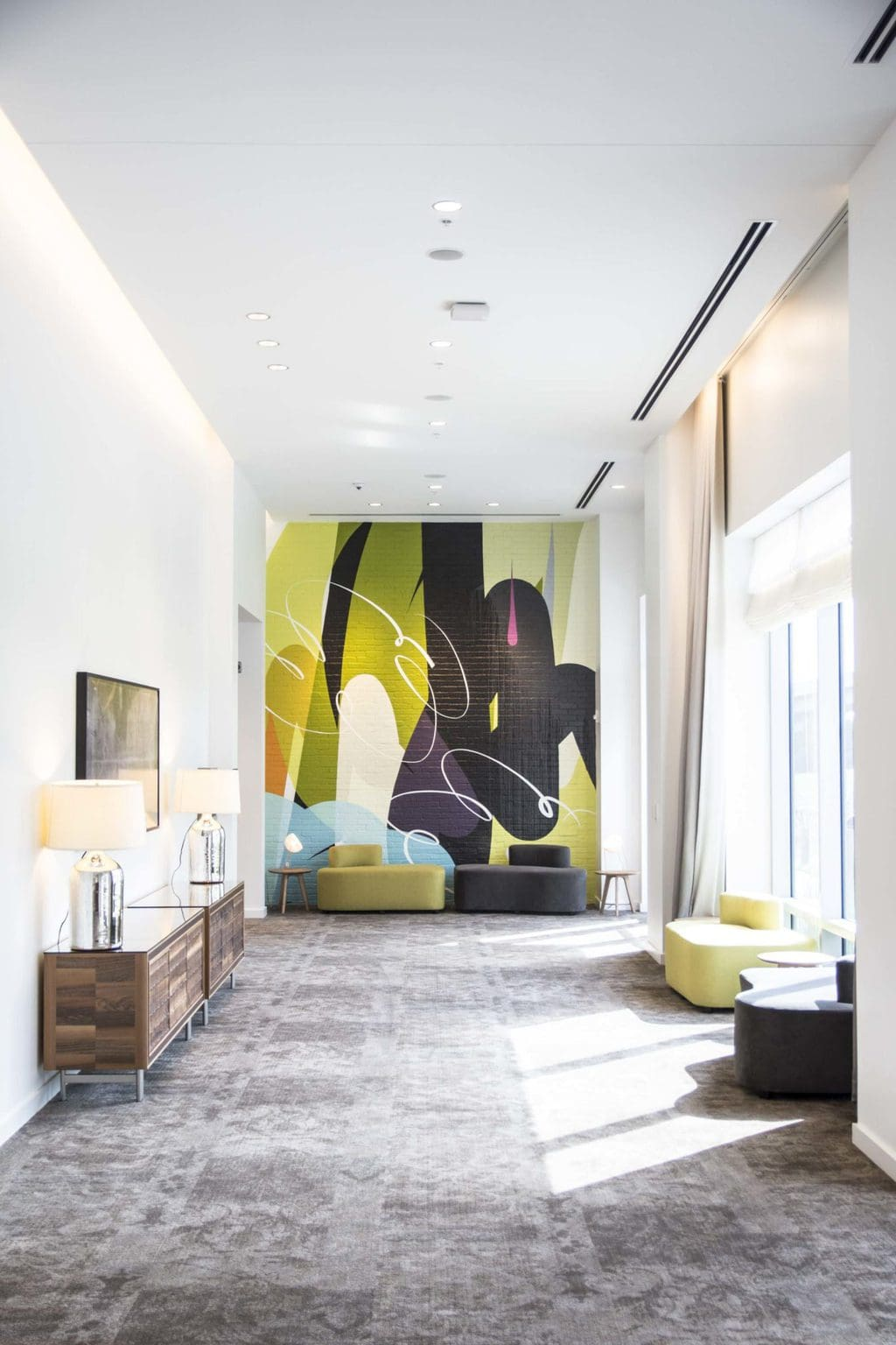 Bright and colorful hotel design with graphic mural at the Renaissance airport hotel on Thou Swell @thouswellblog