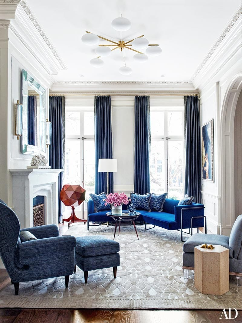 Neo-traditional blue living room with cobalt sectional in New York townhouse on Thou Swell @thouswellblog