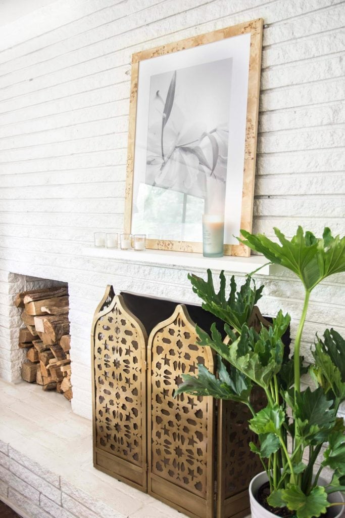 Simple living room white brick fireplace design with Chesapeake Bay Candle on the mantel on Thou Swell @thouswellblog
