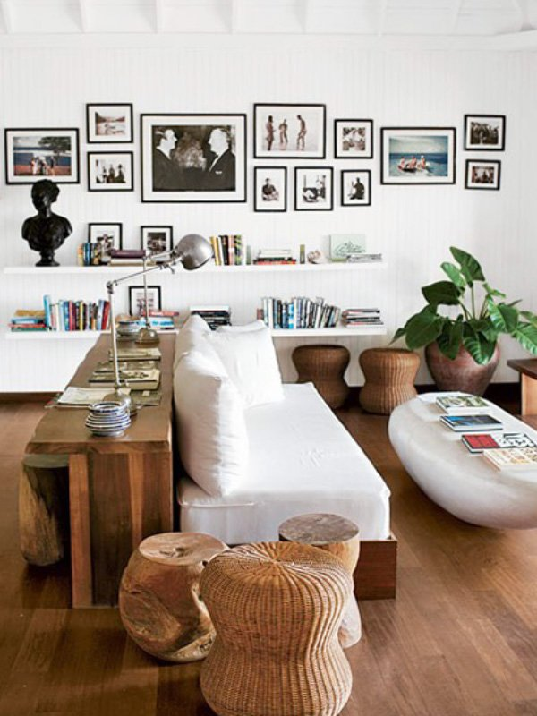 Beach resort living room with modern furniture and gallery wall at GoldenEye on Thou Swell @thouswellblog