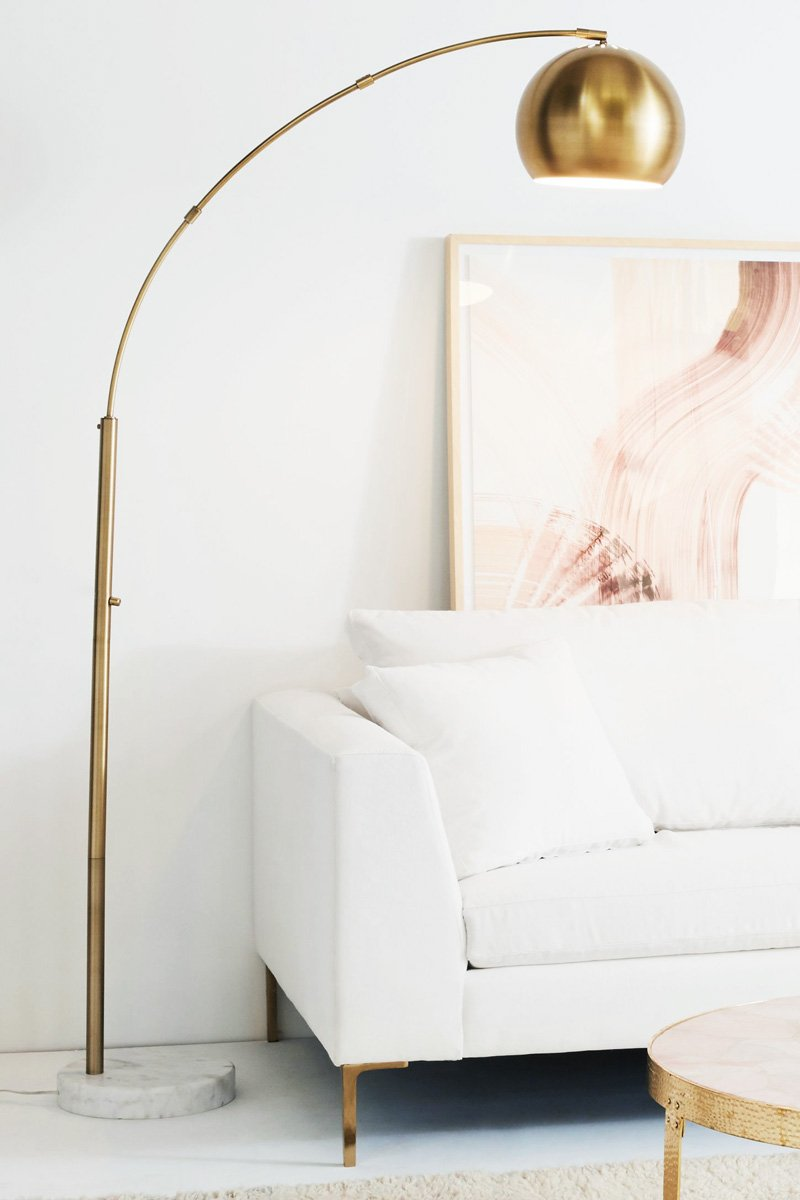 Brass floor lamp and pink wall art in white room on Thou Swell @thouswellblog