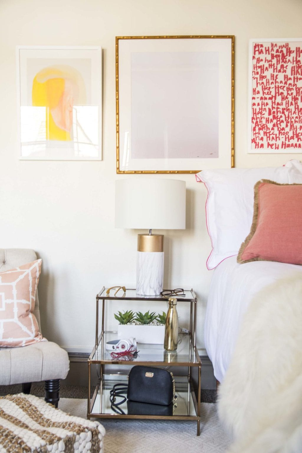 Pink and blush dorm room design with tufted slipper chair and gallery wall on Thou Swell @thouswellblog