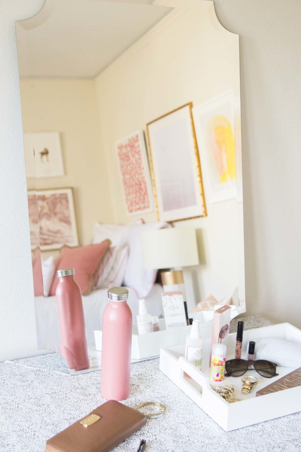 Dorm room dresser with white tray, wall mirror, and contact paper on Thou Swell @thouswellblog