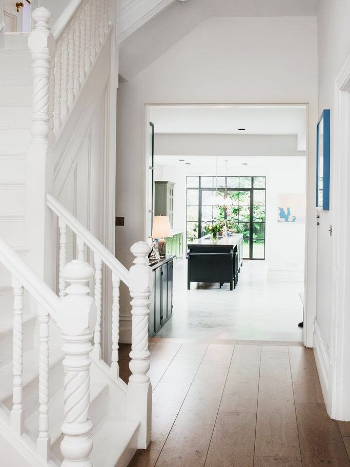 Traditional stair railing painted all white in London townhouse on Thou Swell @thouswellblog