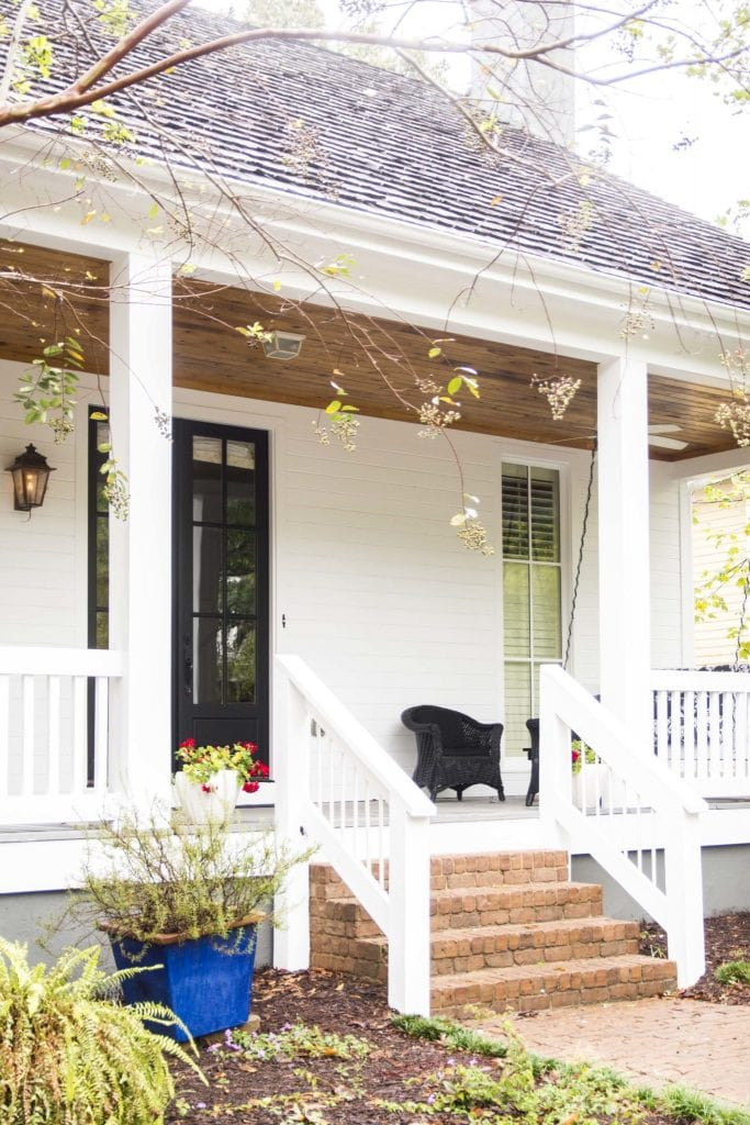 White bungalow with large front porch in sustainable community Serenbe, Georgia on Thou Swell @thouswellblog