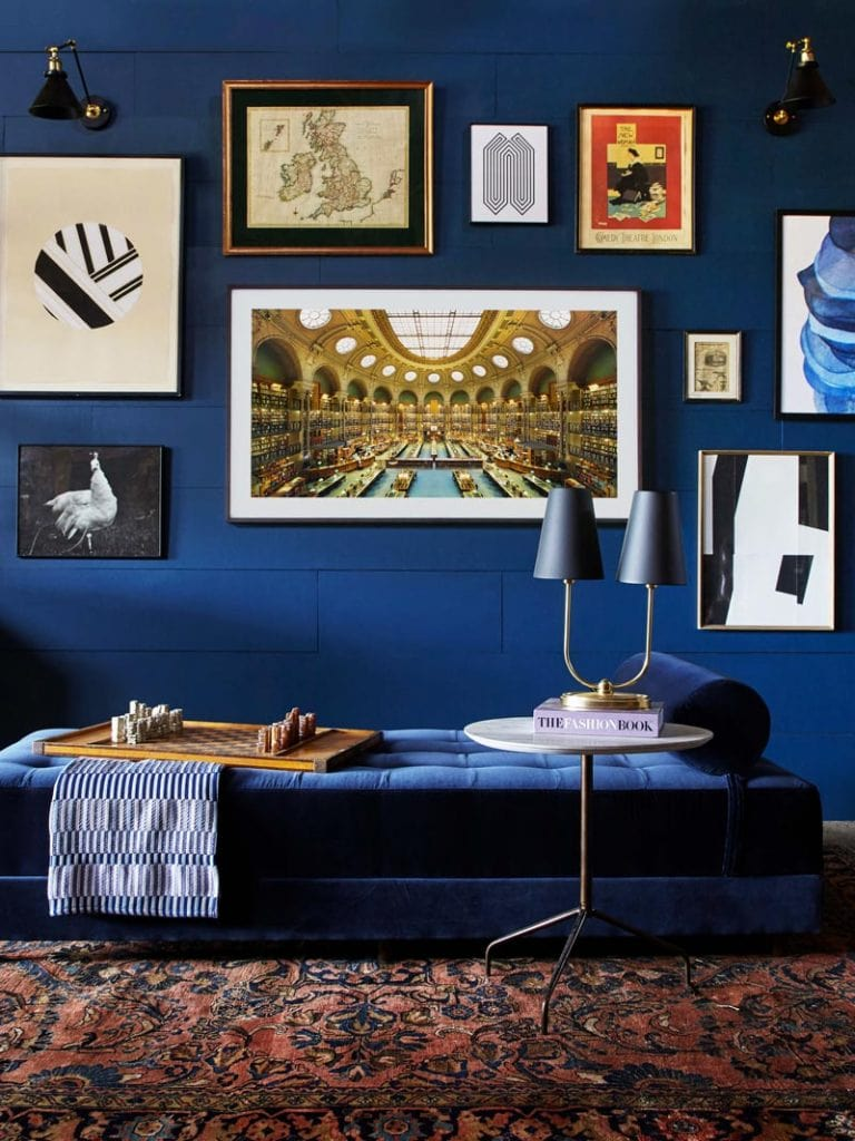 Dark blue library walls with gallery wall and velvet daybed on Thou Swell @thouswellblog