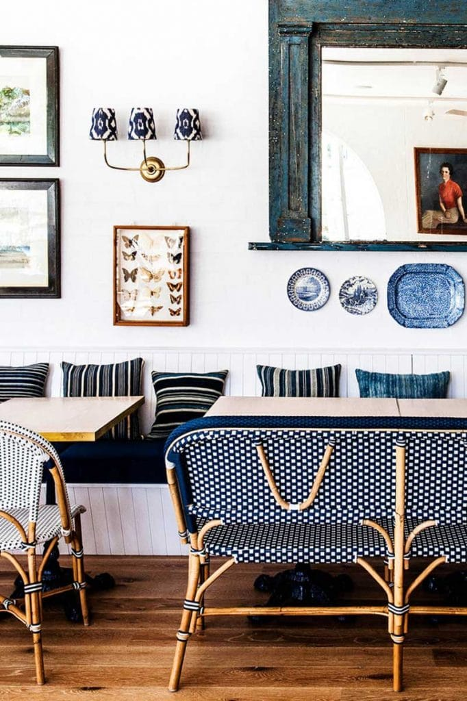 Blue and white banquette dining with gallery wall and sconce light on Thou Swell @thouswellblog