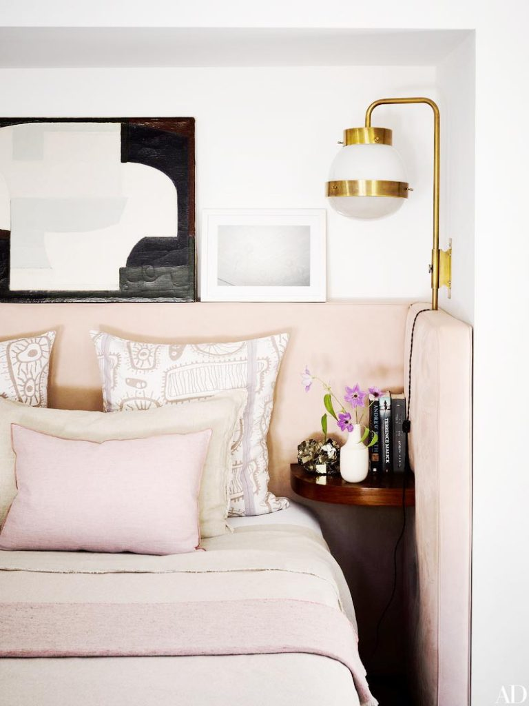 Modern blush bedroom with brass sconces in Los Angeles on Thou Swell @thouswellblog